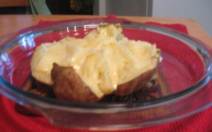baked potato topped with raclette cheese