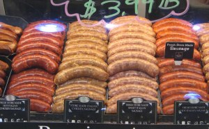 sausages in display case in meat department of Harris Teeter
