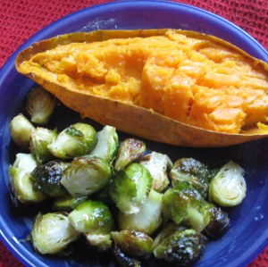 plate with half  a baked sweet potato and roasted Brussels sprouts