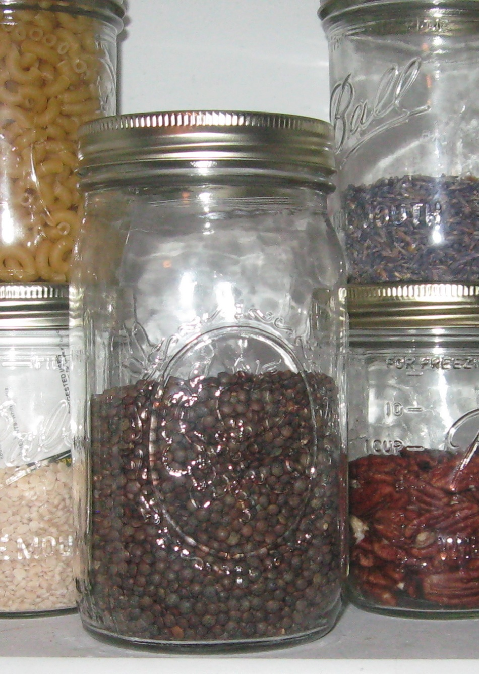 lentils in Mason/Ball jar on pantry shelf.