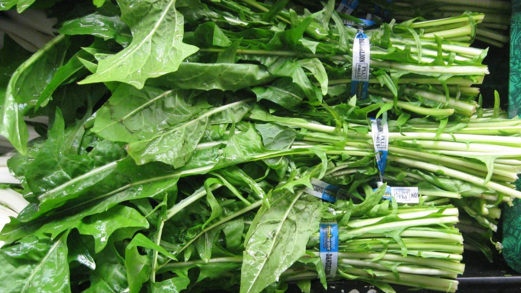 dandelion greens bunched in the Harris Teeter produce department