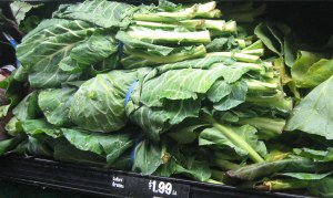 Produce display of bunched collard greens