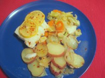 plated cod fillet with cabbage, carrots and potatoes