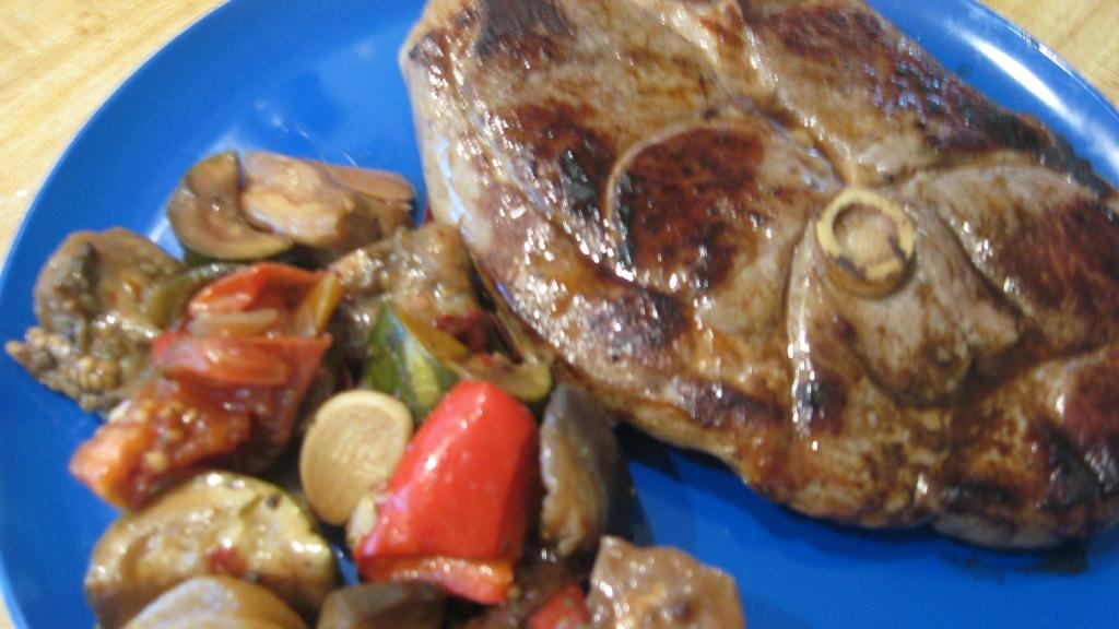 lamb leg steak on plate with ratatouille