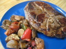 lamb leg steak on plate with ratatouille