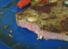 lamb leg steak cut to show pink interior