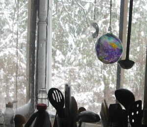 snow covered trees and glass ornament