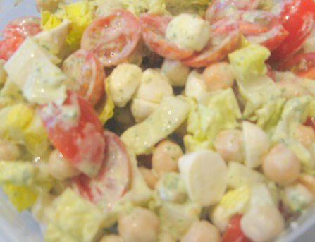 tomato, mozzarella, and garbanzo bean salad, with lemon tahini dressing
