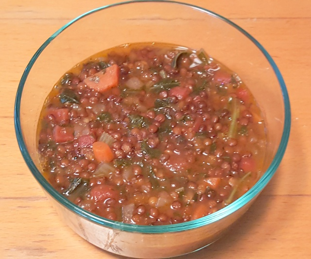 clear glass bowl with lentil soup